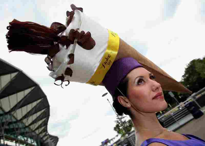 "A racegoer wears an ice-cream cone hat to attend Royal Ascot on ""Ladies Day."" The five-day Royal Ascot is one of the highlights of the U.K.'s horse racing calendar."