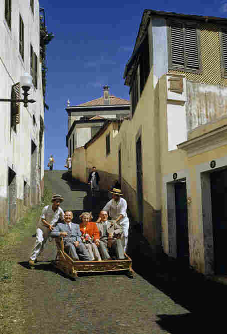In Funchal, Portugal, taxi drivers push visitors up a hill in wooden sledges to admire the view. The trip back down is swift, as they bump along a cobbled road.
