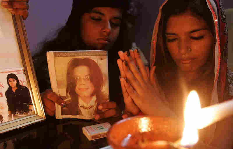 Fans of Michael Jackson take part in a candlelight memorial Friday in Karachi, Pakistan.