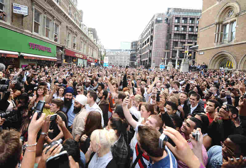 A crowd gathers for a flash mob tribute to Jackson outside Liverpool Street station in London on Friday.