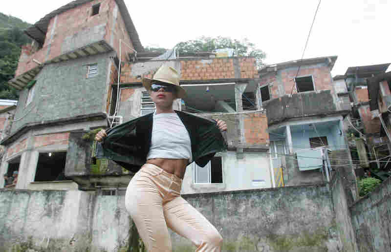 "Jackson fan Antonia Carlos Gomes dances Friday on a roof in the slum of Santa Marta, where Jackson filmed the Spike Lee-directed video ""They Don't Care About Us"" in 1996, in Rio de Janeiro."
