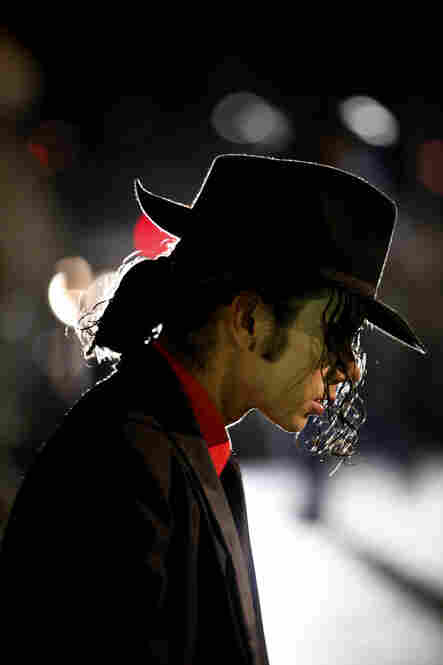 A Jackson fan and impersonator attends a vigil in Mexico City on Thursday.