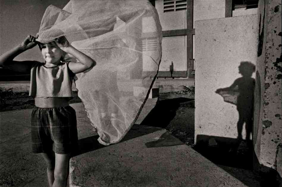 """""""This was my first good picture in Cuba,"""" Ernesto Bazan says of this  girl playing bride in Havana in 1993."""