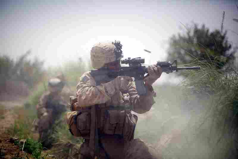 A U.S. Marine engages in a firefight on July 8, in Mian Poshteh, a village in Helmand province in southern Afghanistan.