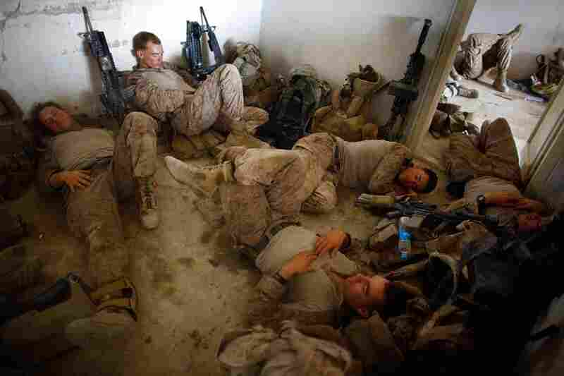 The Marines sleep after a gun battle on July 8, in Mian Poshteh, Afghanistan.