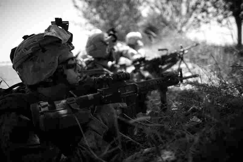 The Marines take cover in a trench as they come under fire, south of the Garmsir district in southern Helmand province.