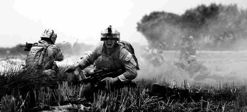 Marines try to find cover during a gunfight with insurgents in the middle of an open field. Gilkey guesses the insurgents were about 700 feet away.  While under fire, he would run along the ditch taking photographs, wearing a helmet and bulletproof vest for protection.