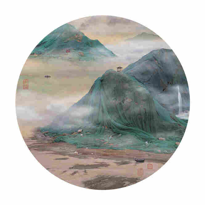"The photographs from Yao Lu's series ""Mountain and Water"" are deceptively beautiful.  What appear to be mountains in mist are actually huge piles of trash and construction waste, shrouded in miles of green netting."
