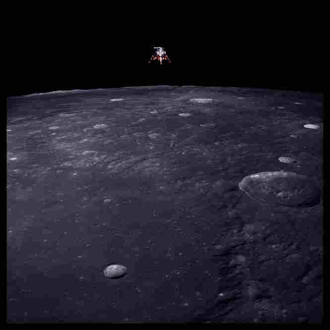 Lunar module Intrepid prepares for descent, 69 miles altitude, photographed by Richard Gordon, Apollo 12, Nov. 14-24, 1969