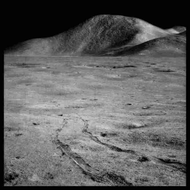 Rover tracks and Mount Hadley rising 15,000 feet over the Marsh of Decay, photographed by James Irwin, Apollo 15, July 26-Aug. 7, 1971