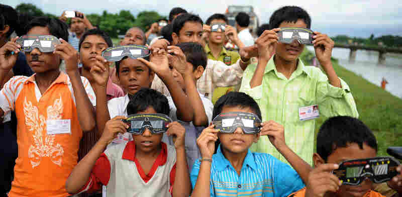 Dozens gather to watch the eclipse in Siliguri in northeast India.
