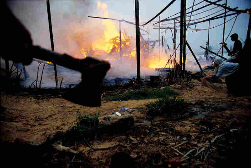 Israeli settlers burned this Palestinian farm at dawn near Khan Yunis, Gaza, November 1993.