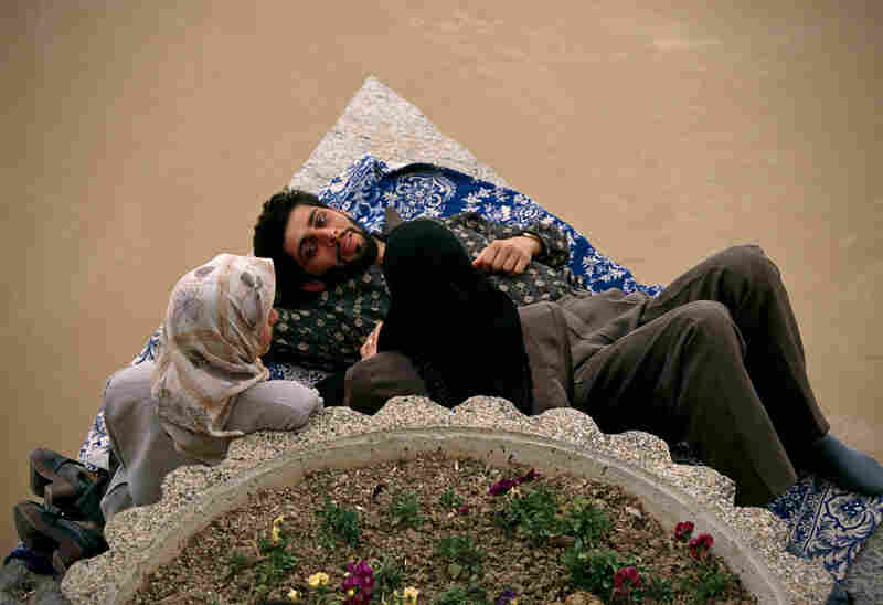 On Khajou Bridge, an engaged couple enjoys a chaperoned visit out of sight of morality police on the other side of the bridge in Isfahan, Iran, March 1998.