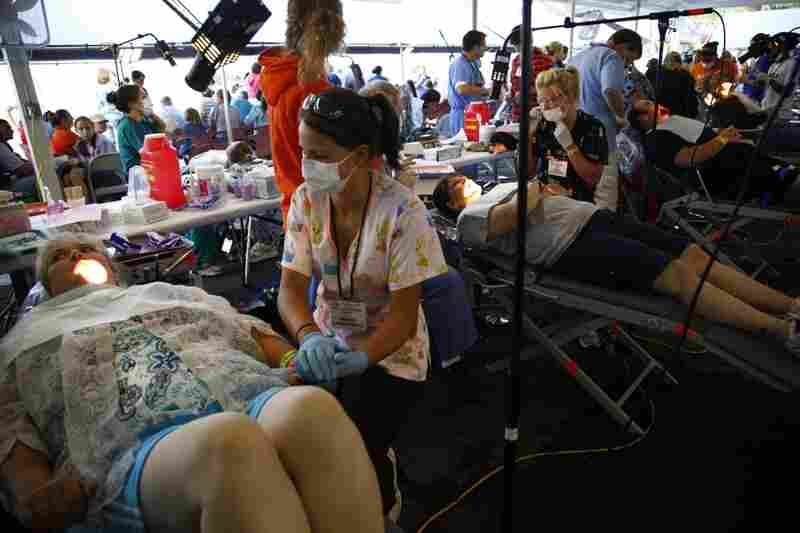 Hundreds of doctors, assistants, and volunteers tend to the steady flow of patients.