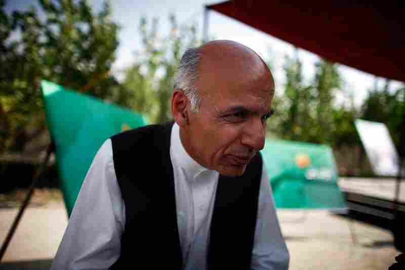 Afghan presidential candidate Ashraf Ghani Ahmadzai, a former World Bank official, greets visitors on the patio of his home.