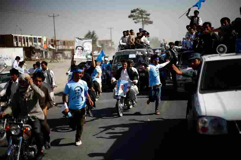 Supporters of Abdullah make their way from the airport to a rally in Herat.