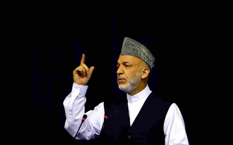 Afghan President Hamid Karzai addresses supporters in Kabul Friday at his first official campaign event.