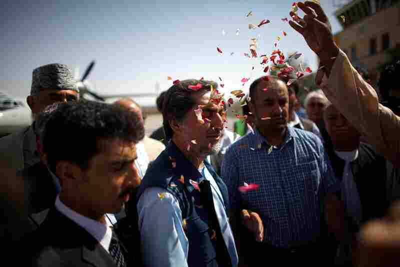 Abdullah accepts a flower petal greeting.