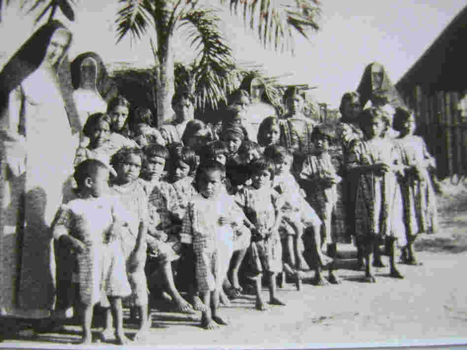Mundurucu mission children stand with German nuns.