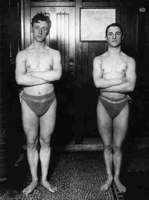 The new full-body suits are a far cry from these worn by British swimmers J. Slane (left) and C. Stephens as they trained for the 1912 Stockholm Olympics.