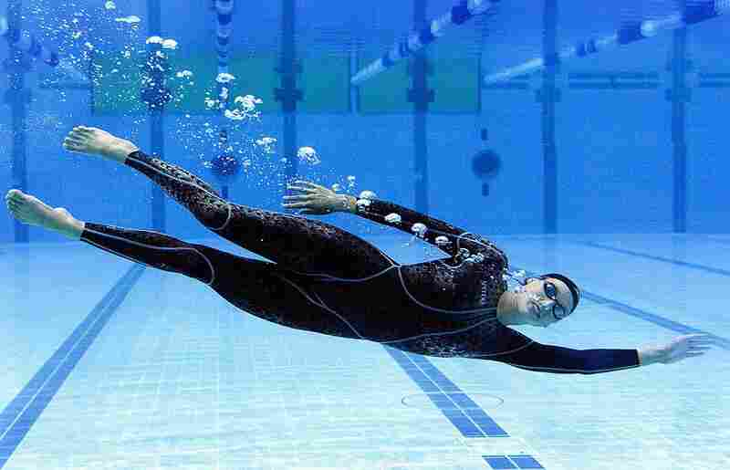 Full-body suits emerged nearly a decade ago, sparking debate over technology that cut swimmers' times. Australian Susie O'Neill shows off a model in 2000. That year, neck-to-ankle suits were cleared for the Olympics.