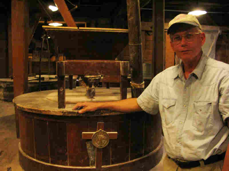 Brother Francis is the Miller at the Saint Vincent Gristmill.  He's pictured here next to one of two one-ton burhstones, brought from France by the monastery's founders in 1846, which are used to grind wheat into flour.