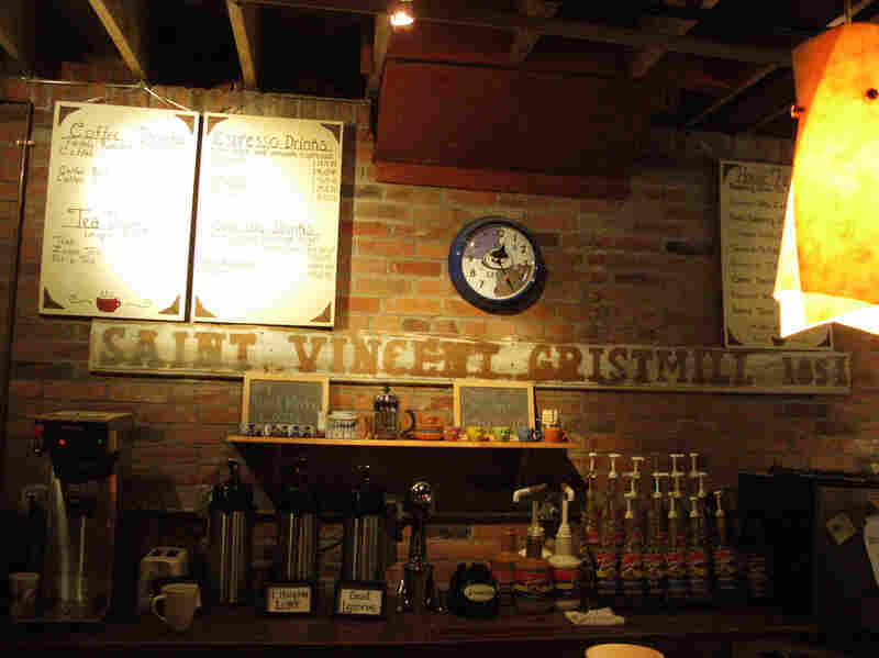 Behind the counter of the Coffehouse, a sign displays the Gristmill's founding year.