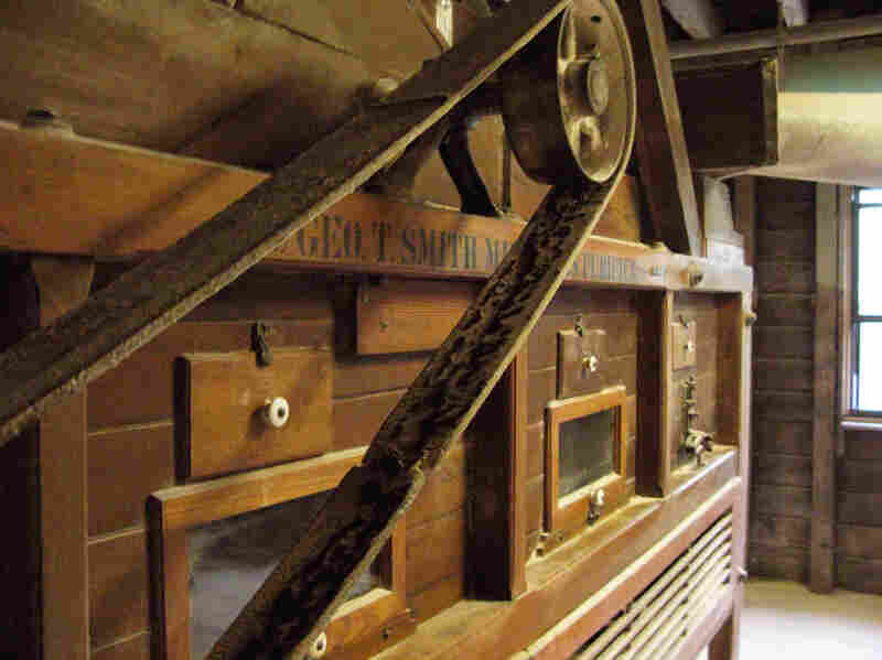 The Gristmill's grain cleaner is located on the second floor, above the burhstones.  Here grain is cleaned before falling one floor below into a hopper, which transfers it to burhstones for grinding.