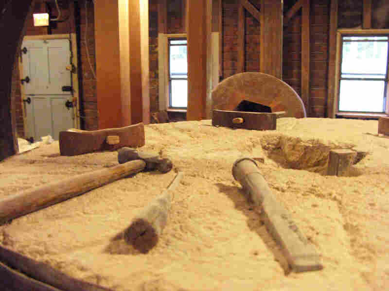 Tools rest on a flour-covered burhstone in the mill.  The craftmanship used in the milling process has gone largely unaltered since 1854.  Only the method of power has changed — from coal to electric.