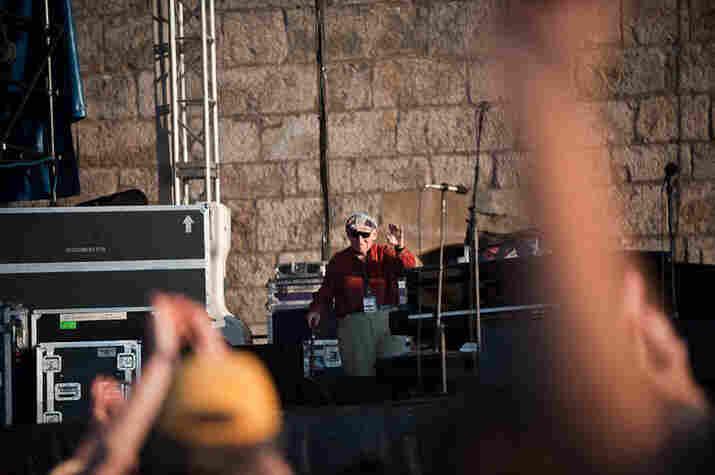 Newport Folk Festival organizer George Wein introduces Pete Seeger.
