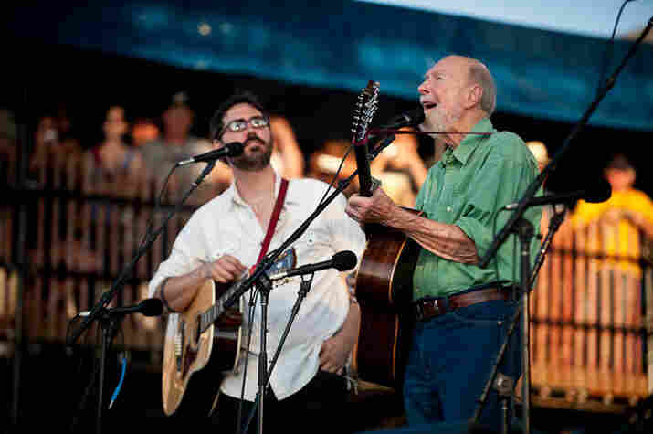 Tao Rodriguez and Pete Seeger start off the singalong.
