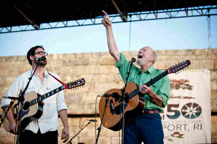 Tao Rodriguez and Pete Seeger leading the singalong at Newport.