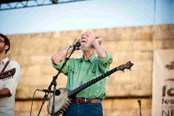 Pete Seeger wants the audience to sing louder.