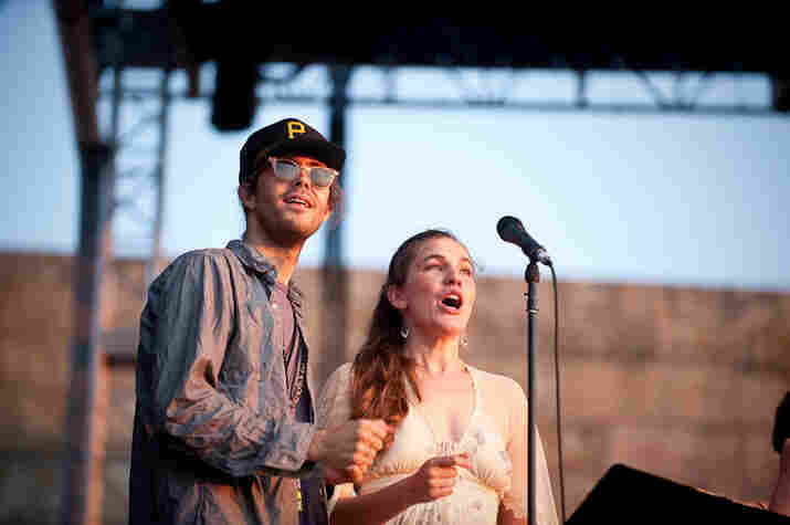 A musician and Becky Stark of The Decemberists at the singalong.