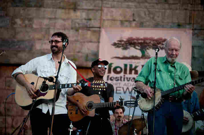 Tao Rodriguez, Tom Morello and Pete Seeger at the singalong.