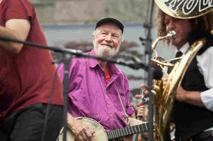 Pete Seeger cracks a smile.