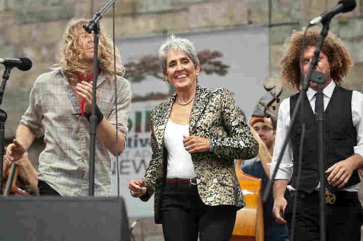 Joan Baez does a little two-step.