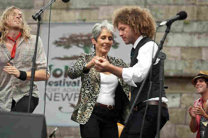 Joan Baez dances with Ben Jaffe.