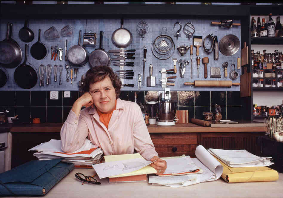 The National Museum of American History in Washington, D.C., recently acquired and installed the wall of copper pots and utensils that were made famous by Julia Child. Here, Child poses in her kitchen in 1970.