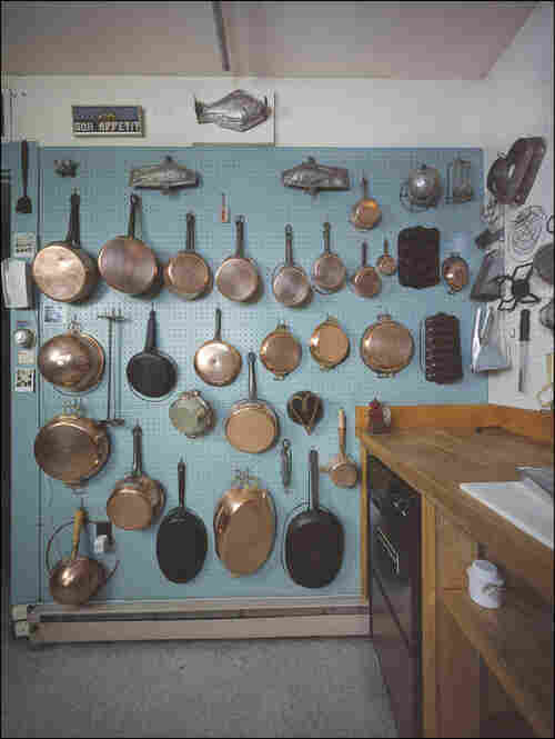 The 30 pots spread across a wall of Child's 14-by-20-foot kitchen in its original location, Cambridge, Mass.