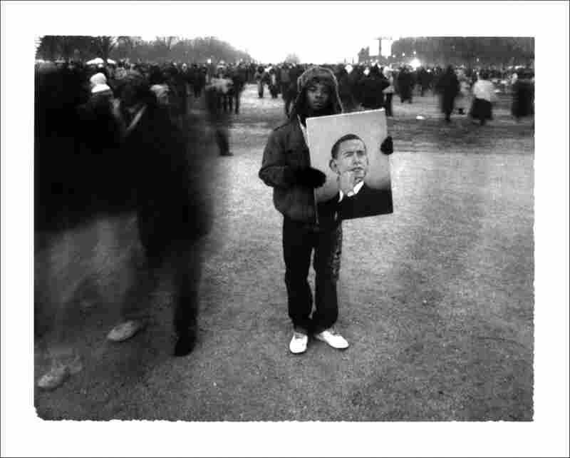 Jeremiah Reed of East Chicago, Ind., holds a portrait of Barack Obama, painted by Omar Spanma,  as crowds filter onto the National Mall before Obama's inauguration.