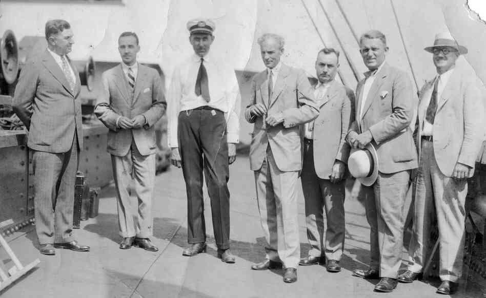 Ford executives stand on the deck of the Lake Ormoc.  Left to right: William Cowling, Edsel Ford, Einar Oxholm, Henry Ford, Pete Martin, Charles Sorensen, and AlbertWibel.