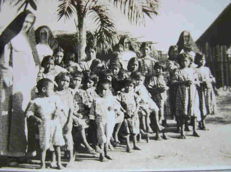 Mundurucu mission children stand with German nuns.