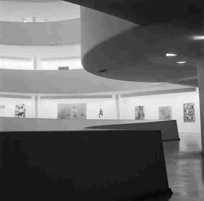The interior of the Guggenheim in 1955. The museum's concrete rings allow light into the building to display exhibits to their full potential.
