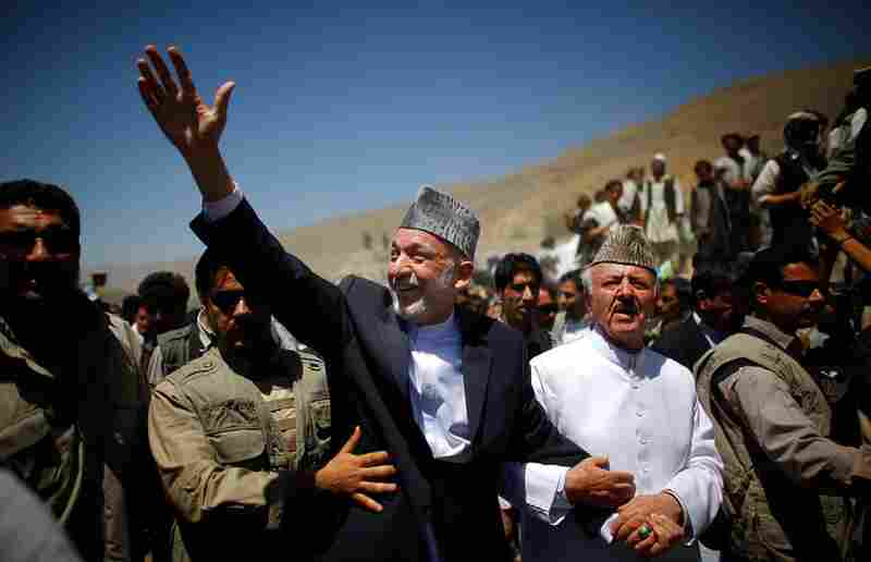 The president, elected in 2004, is accompanied by Naderi, the local religious leader who invited him to the rally.