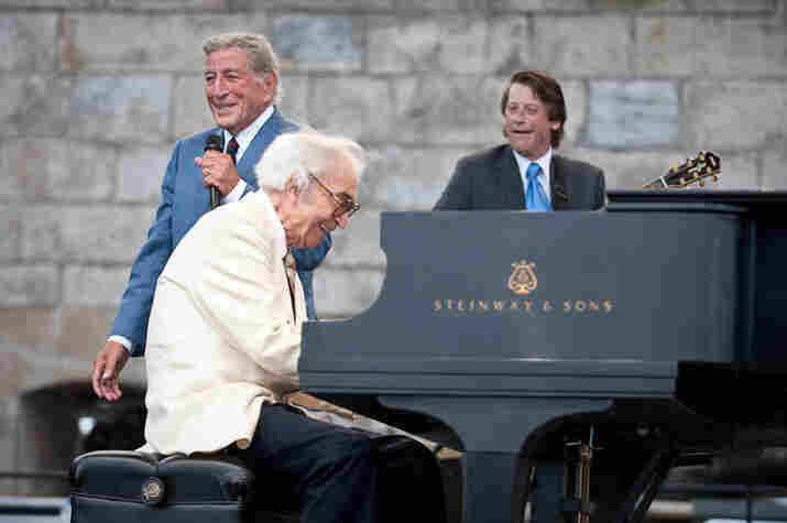 Dave Brubeck plays piano for Tony Bennett.
