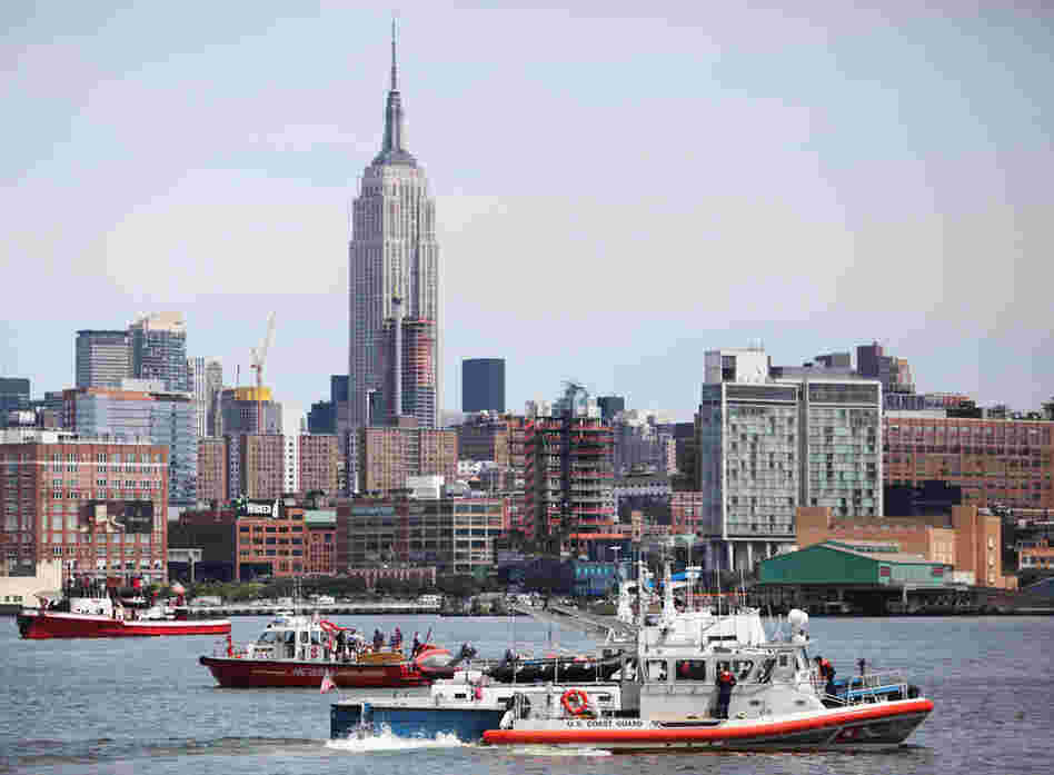 Rescue boats search the Hudson near Hoboken, N.J. A small plane with three people aboard took off from Teterboro Airport in New Jersey before colliding with a helicopter owned by Liberty Tours that carried six people.