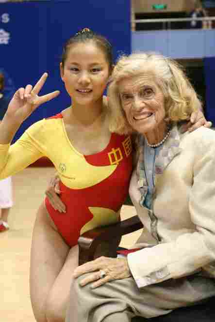 Shriver hugs a gymnast competing at the most recent World Summer Games, held in Shanghai in 2007. The next Summer Games will take place in 2011 in Athens.