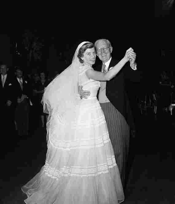 Mrs. Robert Sargent Shriver, the former Eunice Mary Kennedy, left, and her father, former Amb. Joseph P. Kennedy, dance at the reception following her marriage to Robert Sargent Shriver Jr. of Chicago, on May 23, 1953 in New York.