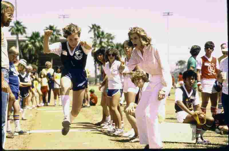 Shriver encourages Special Olympian Karen Fosdick on her way to a gold medal in 1983.